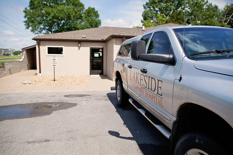 The outside of Lakeside Veterinary Hospital with the hospital truck