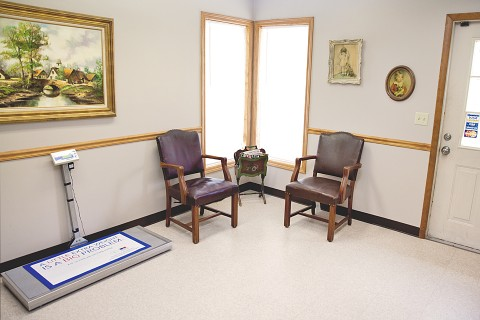 Part of the waiting room with a pet scale